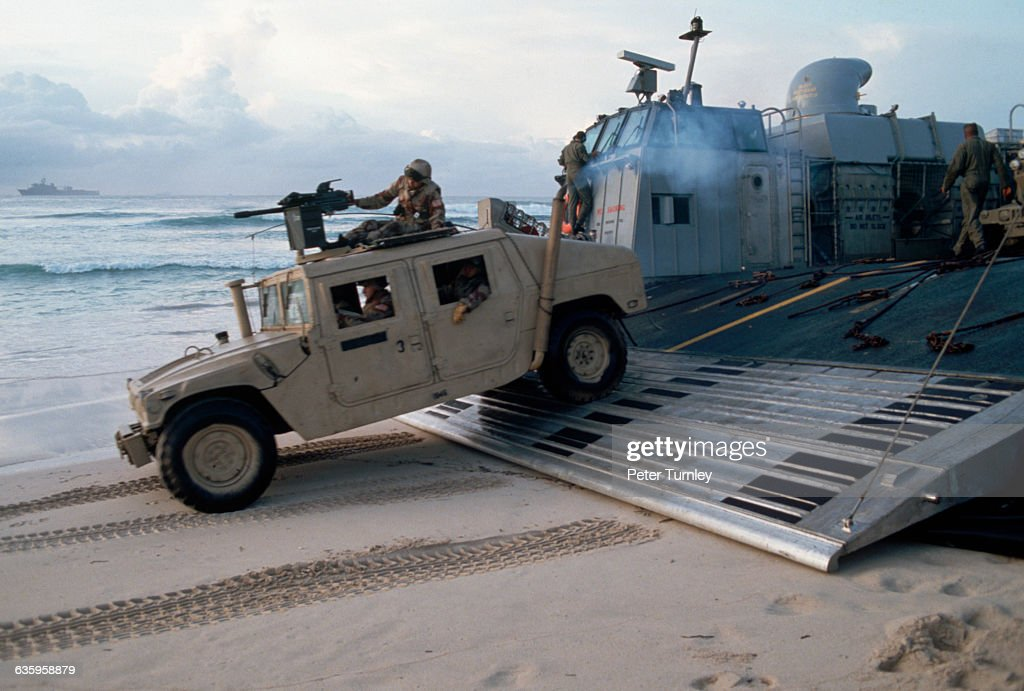 United States Marines drive a multipurpose vehicle onto the sand during an amphibious landing on a Somali beach in December of 1992 In the 1980s a...