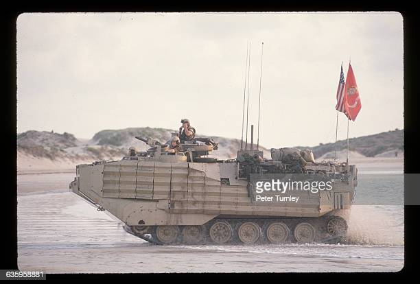 United States Marines drive a personnel carrier along the shoreline after making an amphibious landing on a Somali beach in December of 1992 In the...
