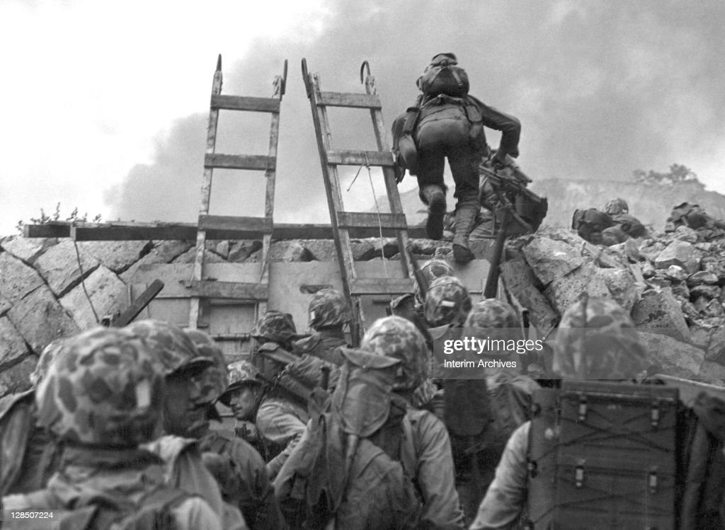 United States Marines use ladders to storm ashore during the amphibious invasion on the northern side of Red Beach at Inchon September 1950...