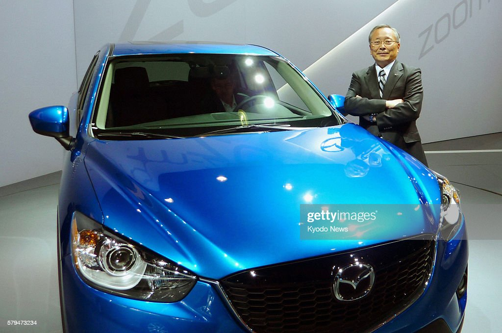 LOS ANGELES United States Mazda Motor Corp President Takashi Yamanouchi stands by the company's CX5 sport utility vehicle in Los Angeles California...