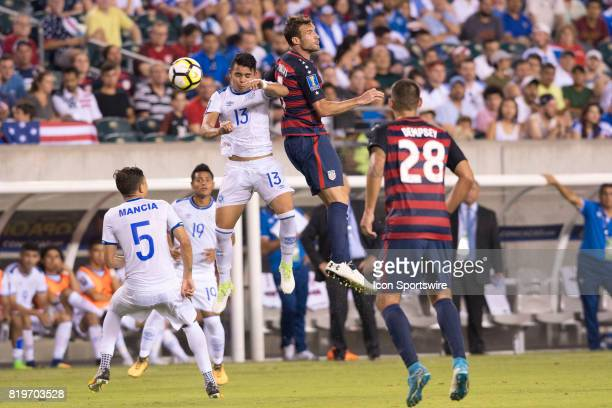 United States Midfielder Chris Pontius and El Salvador Defender Alexander Larín fight for a header in the second half during the CONCACAF Gold Cup...