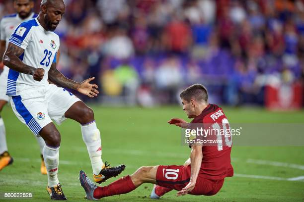 United States midfielder Christian Pulisic battles with Panama defender Felipe Baloy during the World Cup Qualifying match between the the United...