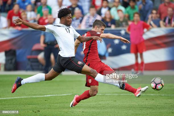 United States midfielder Christian Pulisic battles with Trinidad Tobago defender Mekeil Williams and shoots the ball during the FIFA 2018 World Cup...