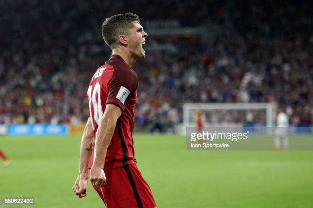 United States midfielder Christian Pulisic celebrates with fans after assisting United States forward Jozy Altidore for scoring a goal during the...