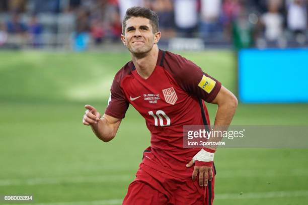 United States midfielder Christian Pulisic celebrates with fans and teammates after scoring a goal during the FIFA 2018 World Cup Qualifier match...