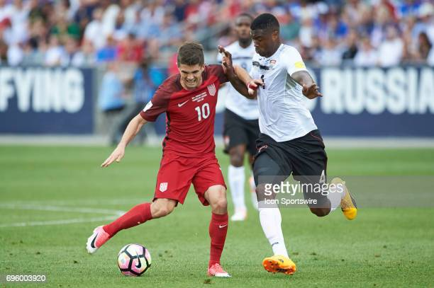 United States midfielder Christian Pulisic dribbles the ball as he battles with Trinidad Tobago defender Sheldon Bateau during the FIFA 2018 World...