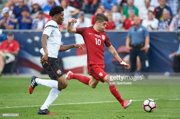 United States midfielder Christian Pulisic dribbles the ball during the FIFA 2018 World Cup Qualifier match between the United States and Trinidad...