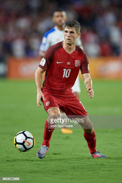 United States midfielder Christian Pulisic dribbles the ball during the World Cup Qualifying match between the the United States and Panama on...