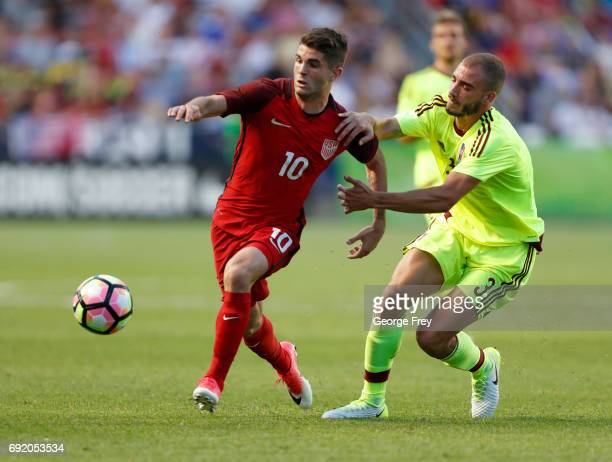 United States midfielder Christian Pulisic fights for the ball with Venezuela's defender Mikel Villanueva during the first half of an international...