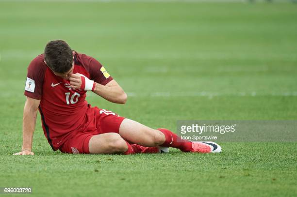 United States midfielder Christian Pulisic picks himself up after a tackle during the FIFA 2018 World Cup Qualifier match between the United States...