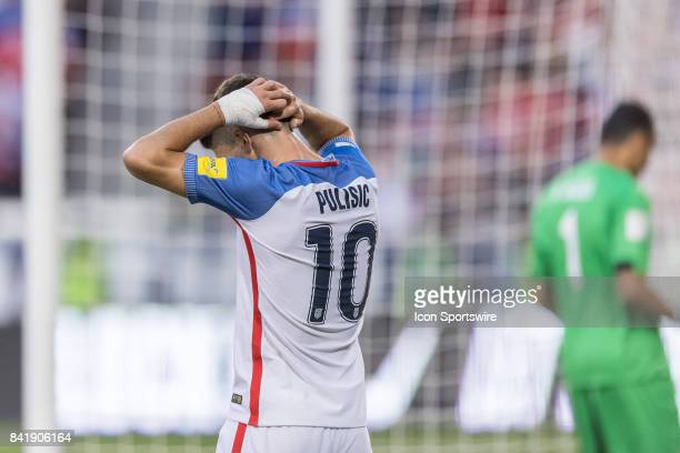 United States midfielder Christian Pulisic reacts after missing a shot on goal during a FIFA World Cup Qualifying match between the United States and...