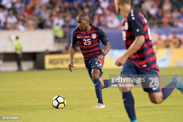 United States Midfielder Darlington Nagbe carries the ball with United States Midfielder Clint Dempsey in the second half during the CONCACAF Gold...