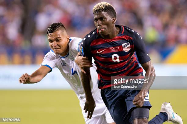 United States Midfielder Gyasi Zardes fights for position over El Salvador Defender Henry Romero in the second half during the CONCACAF Gold Cup...