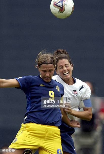 United States midfielder Julie Foudy battles Sweden midfielder Malin Andersson for a ball The US defeated Sweden 3 1 in the opening round of the FIFA...