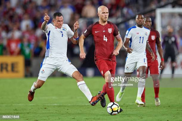 United States midfielder Michael Bradley battles with Panama forward Blas Perez to dribbles the ball during the World Cup Qualifying match between...
