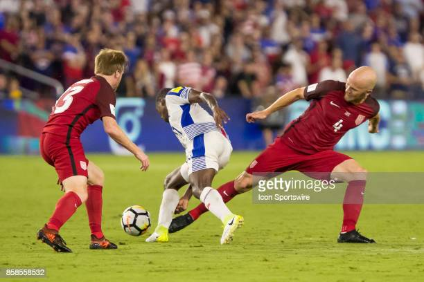 United States midfielder Michael Bradley pokes the ball free during the World Cup Qualifier soccer match between the USA Mens National Team and...