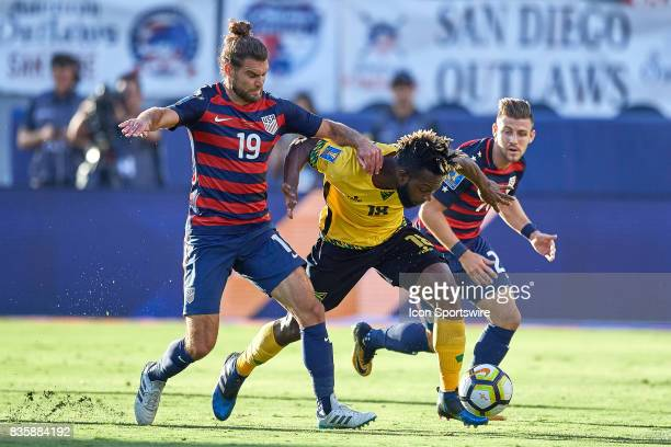 United States midfielder Paul Arriola and United States defender Graham Zusi battle with Jamaica goalkeeper Damion Hyatt during the CONCACAF Gold Cup...
