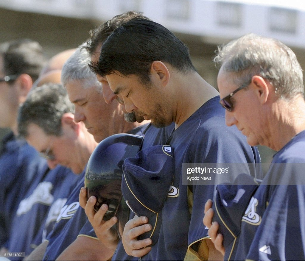 MARYVALE United States Milwaukee Brewers pitcher Takashi Saito and teammates offer a moment of prayer before a spring training game in Maryvale...