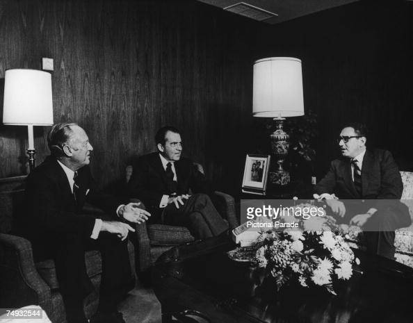 United States National Security Advisor Henry Kissinger briefs US President Richard Nixon and Secretary of State William P Rogers after his mission...