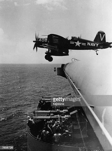 A United States navy Chance Vought F4U Corsair as it leaves the deck of a United States Navy aircraft carrier operating off the coast of Korea for a...