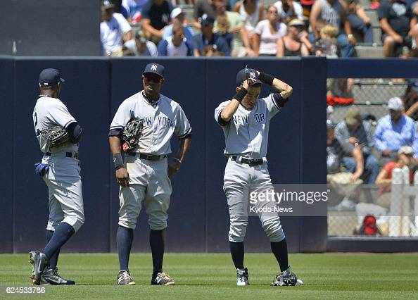 SAN DIEGO United States New York Yankees outfielders Alfonso Soriano Curtis Granderson and Ichiro Suzuki gather after starting pitcher Phil Hughes...