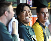 DETROIT United States Oakland Athletics designated hitter Hideki Matsui smiles in the dugout after homering during the sixth inning of a game against...