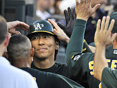 DETROIT United States Oakland Athletics designated hitter Hideki Matsui is congratulated by his teammates after homering during the sixth inning of a...