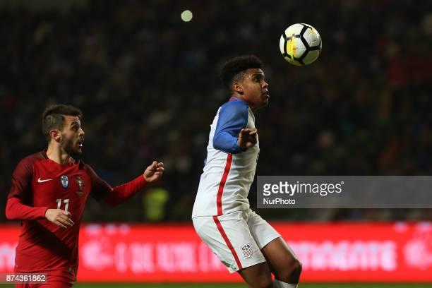 United States of America midfielder Weston McKennie and Portugal midfielder Bernardo Silva during the match between Portugal and United States of...