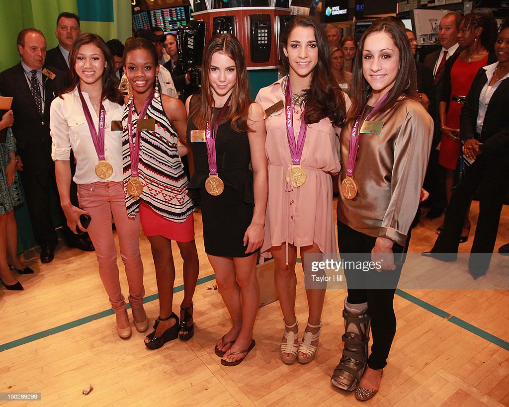 United States Olympic gold medalist gymnasts (L-R) <a gi-track='captionPersonalityLinkClicked' href=/galleries/search?phrase=Kyla+Ross&family=editorial&specificpeople=6920700 ng-click='$event.stopPropagation()'>Kyla Ross</a>, <a gi-track='captionPersonalityLinkClicked' href=/galleries/search?phrase=Gabby+Douglas&family=editorial&specificpeople=8465211 ng-click='$event.stopPropagation()'>Gabby Douglas</a>, <a gi-track='captionPersonalityLinkClicked' href=/galleries/search?phrase=McKayla+Maroney&family=editorial&specificpeople=7138673 ng-click='$event.stopPropagation()'>McKayla Maroney</a>, Aly Raisman, and Jordan Wieber ring the closing bell at the New York Stock Exchange on August 14, 2012 in New York City.