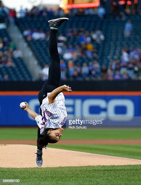 United States Olympic Gymnastics gold medalist Laurie Hernandez does a flip as she throws out the first pitch before a game between the Washington...