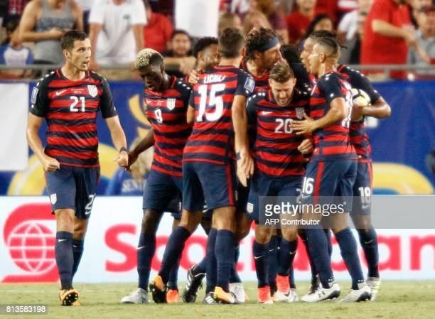 United States players celebrate after a goal by Omar Gonzalez in the second half against Martinique during their Group B Gold Cup soccer game on July...