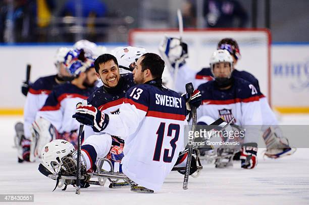 United States players celebrate after the Ice Sledge Hockey Playoff semi final between Canada and the United States of America during day six of...