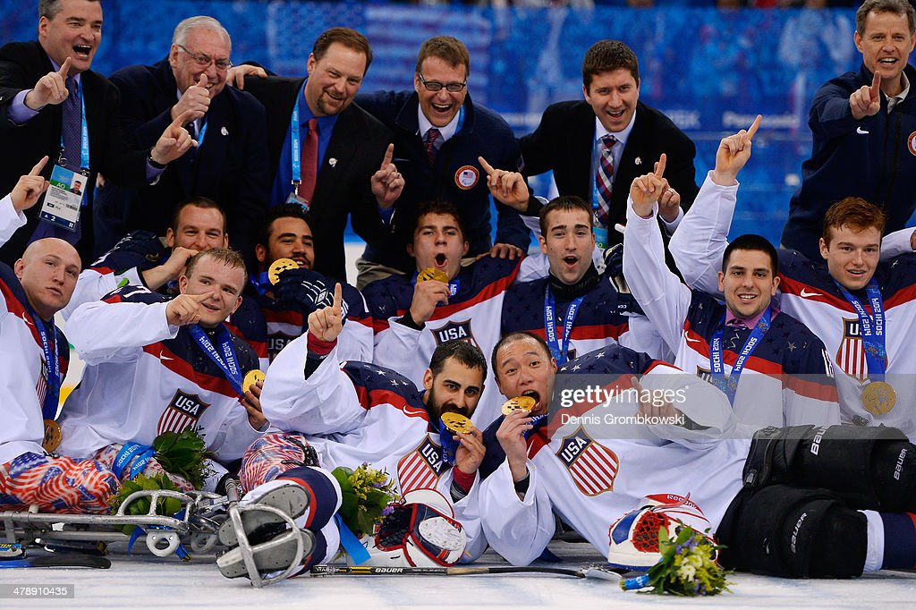 United States players celebrate after winning gold in the ice sledge hockey gold medal game between the Russian Federation and the United States of America at the Shayba Arena during day eight of the 2014 Paralympic Winter Games on March 15, 2014 in Sochi, Russia.