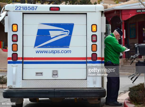 United States Postal Service postman delivers mail along Canyon Road in Santa Fe New Mexico The USPS mail trucks known as Grumman LLV were...
