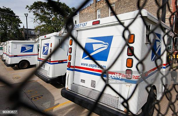 United States Postal Service trucks sit outside the Roberto Clemente Post Office August 25 2009 in Chicago Illinois The Postal Service announced it...