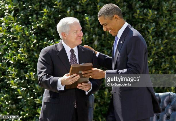 United States President Barack Obama presents Secretary of Defense Robert Gates with the Presidential Medal of Freedom during his Armed Services...