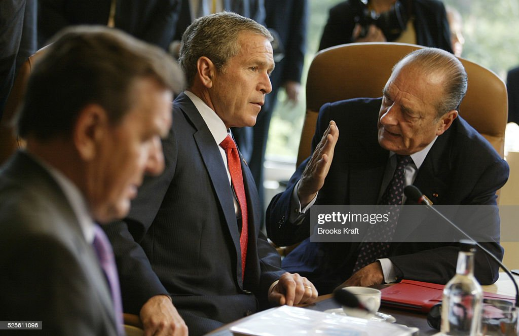 United States President George Bush and French President <a gi-track='captionPersonalityLinkClicked' href=/galleries/search?phrase=Jacques+Chirac&family=editorial&specificpeople=165237 ng-click='$event.stopPropagation()'>Jacques Chirac</a> talk before a working session at the G8 Summit. German Chancellor Gerhard Schroeder (L) also attended.