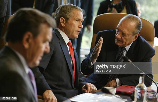 United States President George Bush and French President Jacques Chirac talk before a working session at the G8 Summit German Chancellor Gerhard...