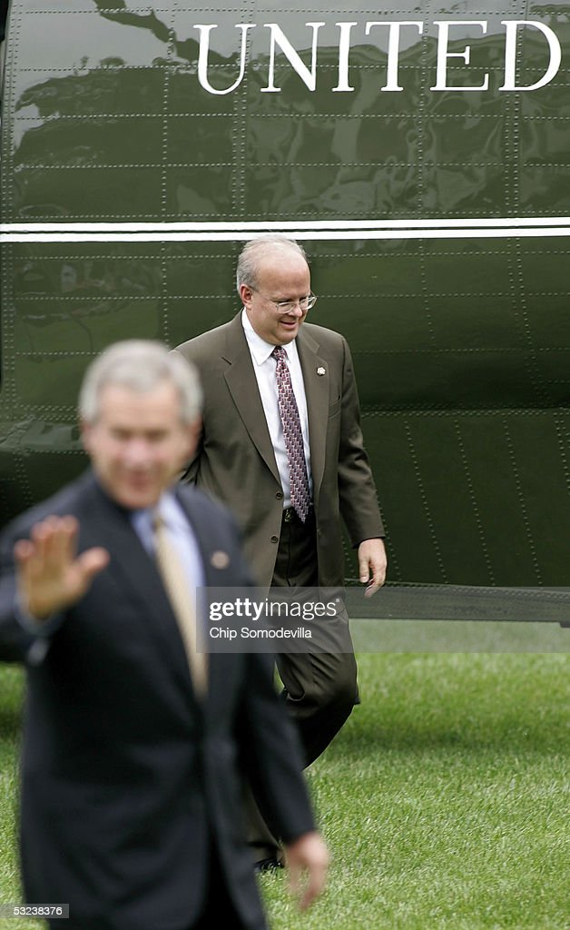United States President George W. Bush and Deputy Chief of Staff Karl Rove walk from Marine One across the South Lawn to the Oval Office at July 14, 2005 at the White House in Washington, DC. Bush is returning after making remarks at the Indiana Black Expo Corporate Luncheon in Indianapolis, IN.
