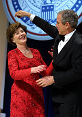 United States President George W Bush and his wife Laura dance at the first inaugural ball in Washington DC The Bushes were scheduled to attend eight...
