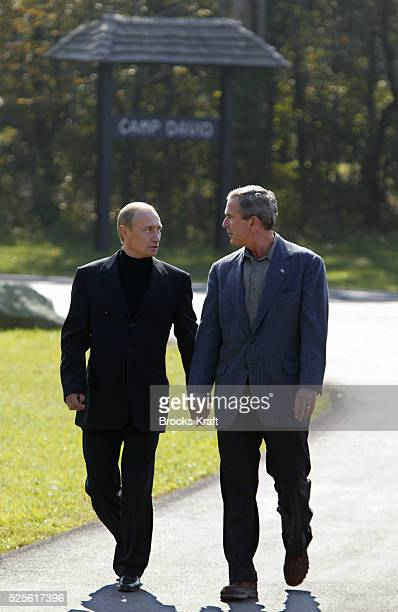 United States President George W Bush and Russian President Vladimir Putin walk along a pathway at Camp David following two days of talks Bush and...