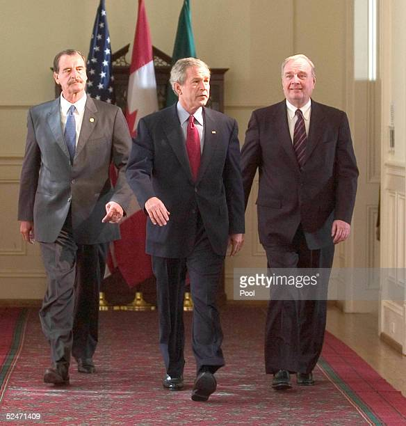 United States President George W Bush Canadian Prime Minister Paul Martin and Mexican President Vicente Fox walk to attend a press conference at the...