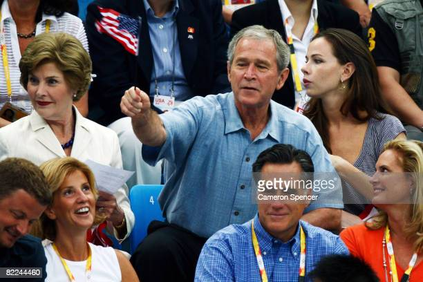 United States President George W Bush First Lady Laura Bush and daughter Barbara Bush attend the National Aquatics Center on Day 3 of the Beijing...