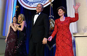 United States President George W Bush his wife Laura and daughers Jenna and Barbara attend the first inaugural ball in Washington DC The Bushes were...