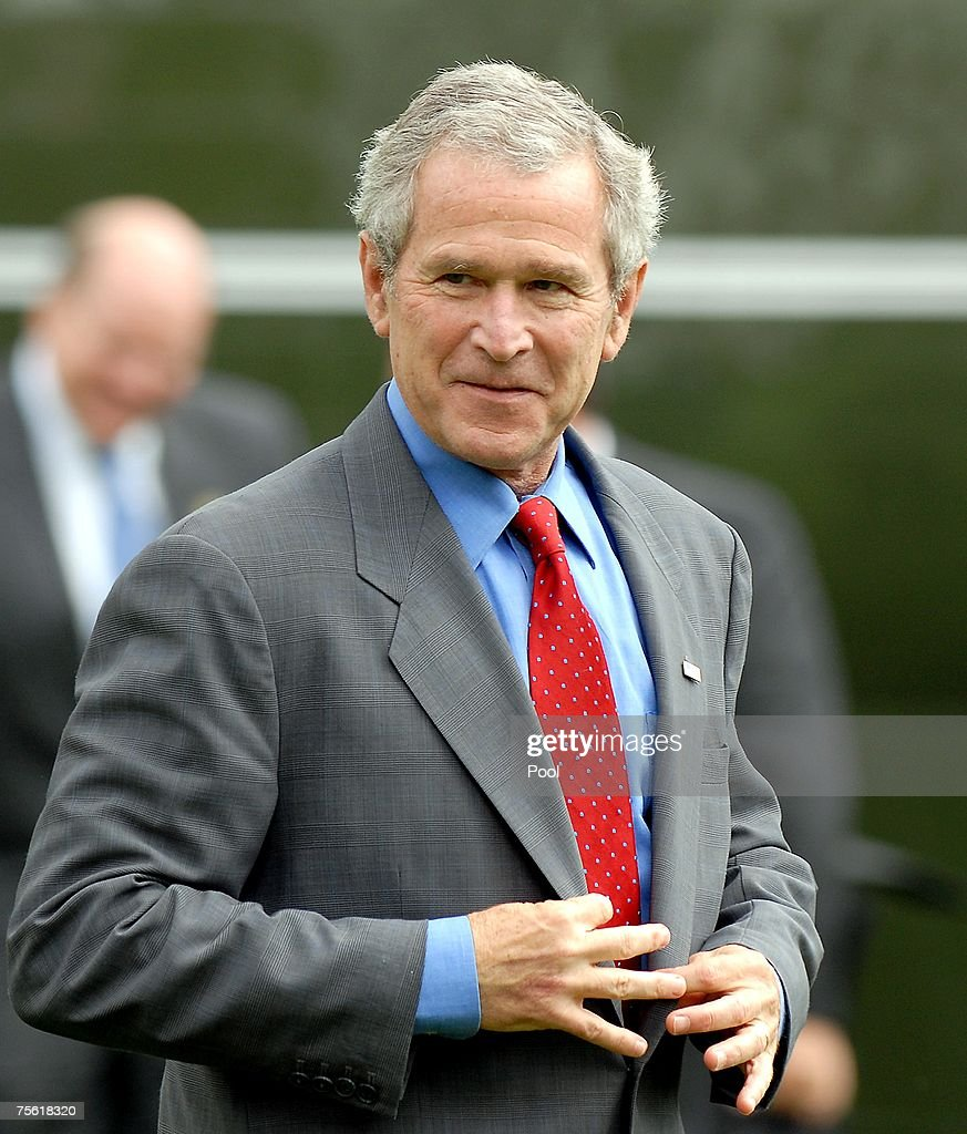 United States President <a gi-track='captionPersonalityLinkClicked' href=/galleries/search?phrase=George+W.+Bush&family=editorial&specificpeople=122011 ng-click='$event.stopPropagation()'>George W. Bush</a> poses as he walks to the Oval Office after arriving from Charleston Air Force Base in Charleston, South Carolina to the White House on July 24, 2007 in Washington, DC. Bush is under increasing pressure to withdraw troops from Iraq as intelligence reports indicate that the war in Iraq is a recruiting ground for Al-Qaeda.
