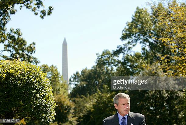 United States President George W Bush pushes his administration's 'Clear Skies' Initiative a plan for reducing harmful mercury nitrogen oxide and...