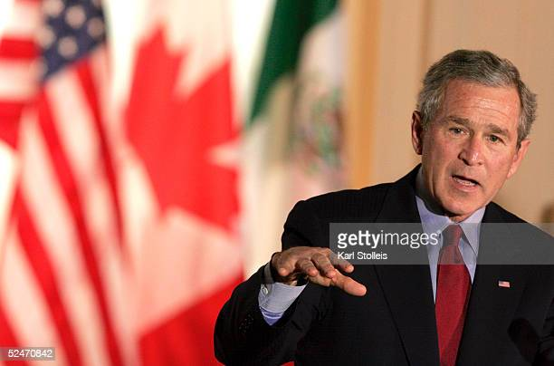United States President George W Bush speaks at a press conference with Canadian Prime Minister Paul Martin and Mexican President Vicente Fox at the...