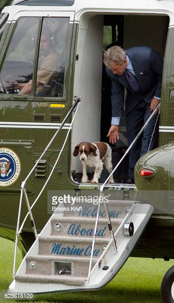 United States President George W Bush steps off Marine One with his pet dog Spot on the South Lawn of the White House President Bush was returning...
