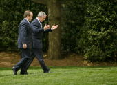 United States President George W Bush talks with his Press Secretary Scott McClellan while walking to the West Wing May 5 2006 in Washington DC Bush...