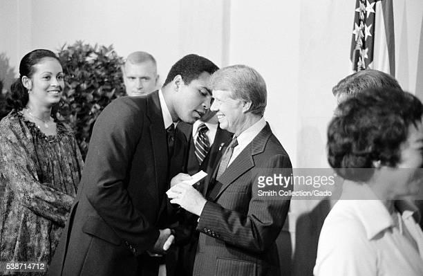 United States President greets boxer Muhammad Ali at a white house dinner celebrating the signing of the Panama Canal Treaty Washington DC Image...